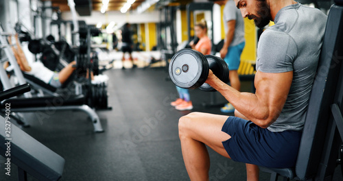 Fotografie, Obraz  Young handsome man doing exercises in gym