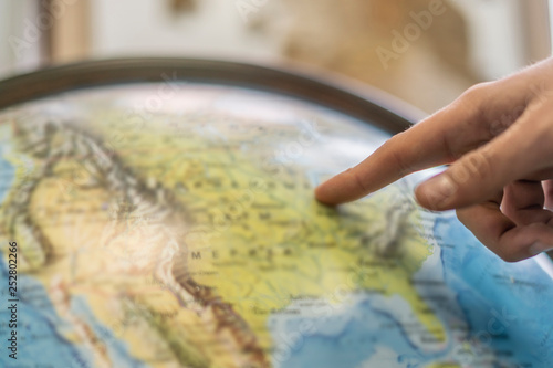 Photo persons finger point at globe and choose destination b