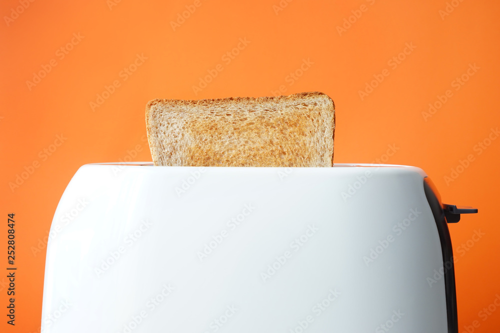 Fototapety, obrazy: Slice of bread with toaster on color background