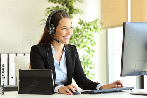 Tele marketer working at office with computer Canvas Print