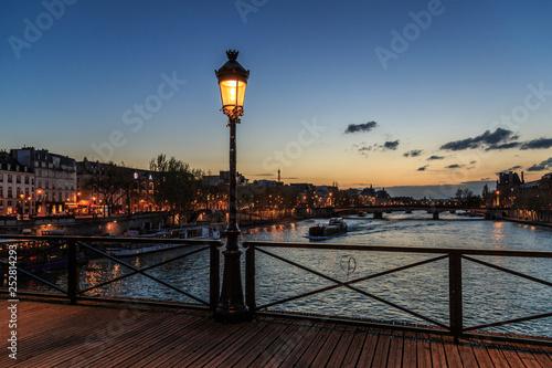Pont des arts street lamp at night. Paris seine bridge with lantern. Morning river view