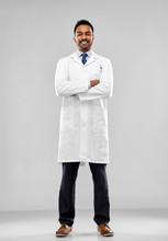 Medicine, Science And Profession Concept - Smiling Indian Male Doctor Or Scientist In White Coat Over Grey Background