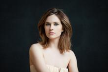 Candid Girl On Blackboard Background Portrait. Beautiful Woman In Day Light