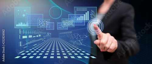 Fotografia, Obraz  Woman touching a business digital interface concept