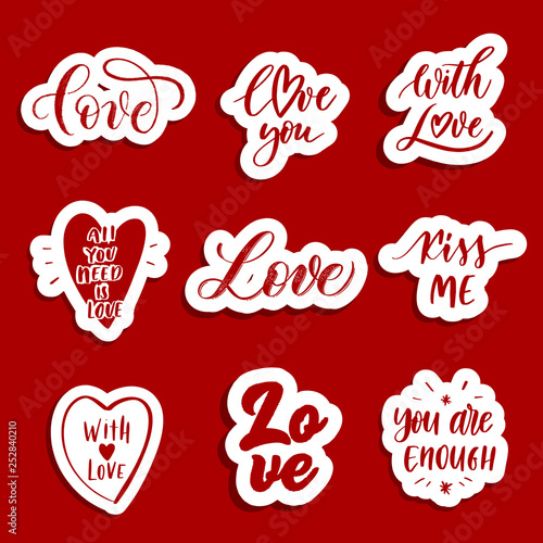 Photo  Hand  lettering red  patches and stickers - creative set incuding inscriptions: Love, love you, kiss me, all you need is love, with love, you are enough