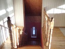 Wooden Staircase And Arched Wi...