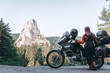 Woman biker and adveture motorcycle on mountain road in Bicaz Canyon, Romania. Travel concept, extreme, vacation in Europe, motorcyclist way, tourism, Cheile Bicazului, Europe. copy space