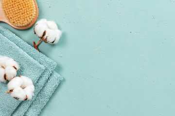 Stack of blue bath towels on the blue textured background