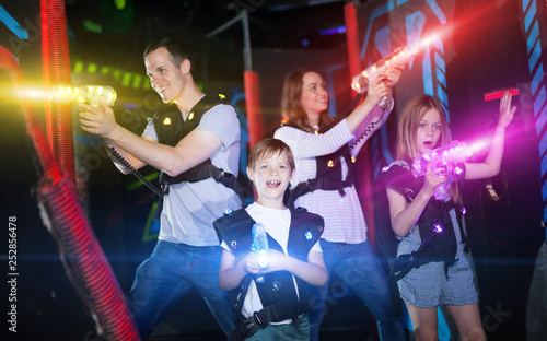 Photo  Kids and adults in beams on lasertag arena