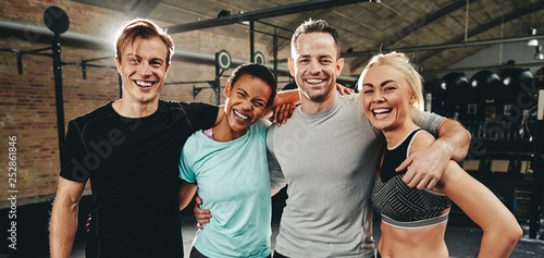 Photo sur Toile Kiev Diverse friends laughing after a workout at the gym