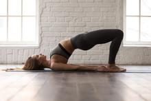 Woman Practicing Yoga, Glute B...