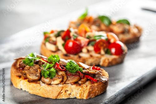 Fotografiet  Assortment of traditional Italian bruschettas