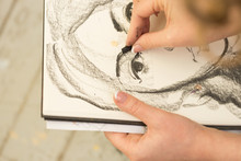 Young Girl Doing A Sketch Of N...