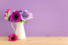 Spring Bouquet Of Colorful Anemones In The Vase Over Wooden Table