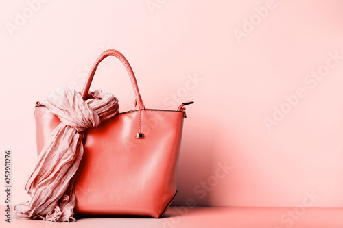 Photo Female handbag with scarf on living coral background