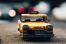 Mini Taxi Parked On The Street At Sunset