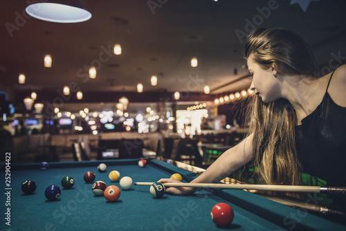 Wallpaper Mural Beautiful woman with long hair playing billiard