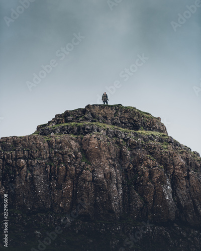 Photo Man reached a hilltop in scotland summit goal success overlook panorama