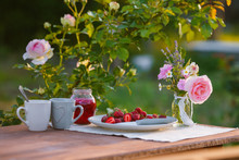 Morning Tea In The Garden. Fresh Roses On Wooden Table, Sunny Day, Natural Ligh