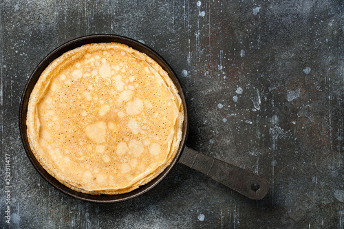 Fotografie, Obraz  Homemade pancakes on iron pan