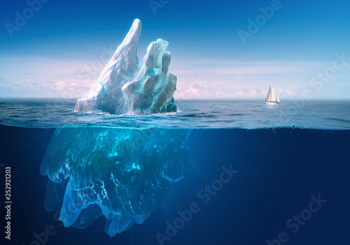 Fotografia Ice in water, iceberg in blue ocean