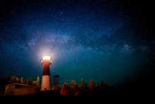 A Lighthouse At Night With A S...