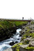 One Person Crossing The Wooden Bridge At The Start Of Stage Two Of Fimmvörduhals Mountain Pass, Iceland