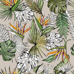 Fototapeta Egzotyczne Seamless pattern with tropical leaves and exotic strelitzia flowers. Hand drawn vector on beige background.