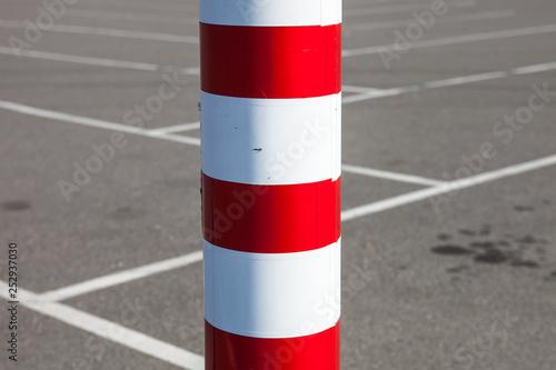 Fotografía Metal pole on the parking lot