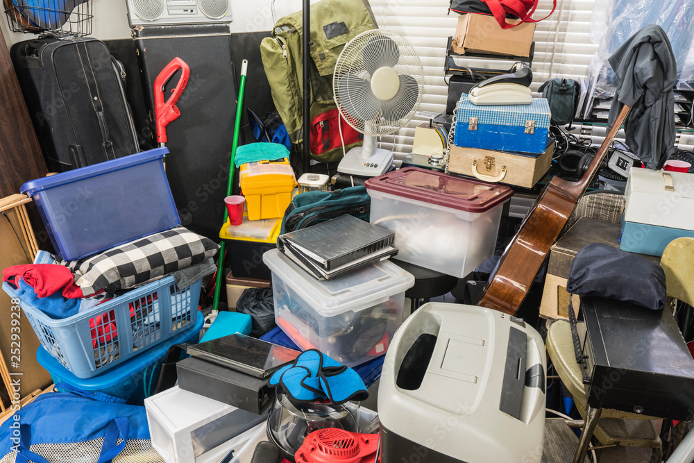 Fototapeta Hoarder home packed with stored boxes, vintage electronics, files, business equipment and household items.