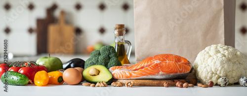 Fotografía  Fresh vegetables, fruits, nuts and salmon steak.