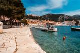 Fototapeta Do pokoju - Moored yachts stand in the port town