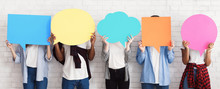 Teenagers Holding Speech Bubbles With Copy Space