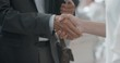 close up business people shaking hands corporate partnership deal welcoming opportunity for cooperation in office