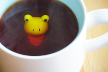 Cute Frog Figurine In The White Mug With Babyblue Base