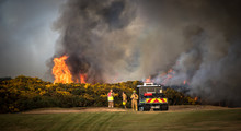 Wildfire With Firefighters At Golf Course