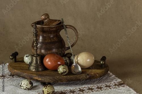 Fototapeta Festive Easter still life with eggs and earthenware jug. Blank for postcards. obraz