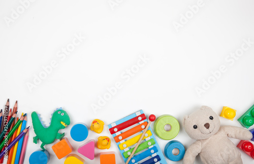 Obraz Baby kids toys on white background with copy space for text - fototapety do salonu