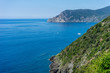 Italy, Cinque Terre, Corniglia, a body of water with a mountain in the background