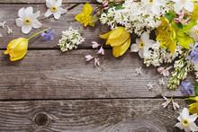 Spring Flowers On Wooden Backg...