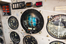 Dashboard Of An Old Airplane. The Main Aircraft Gauge, Artificial Horizon.