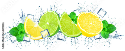 Fototapeta lime and lemon with water splash isolated on white obraz
