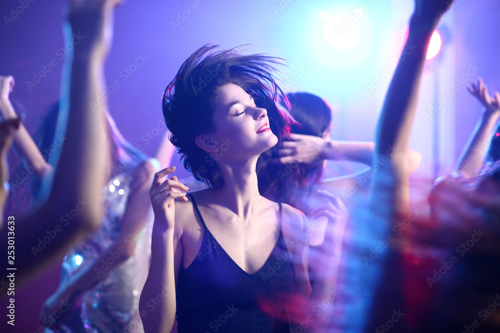 Fototapeta Beautiful young women dancing in night club