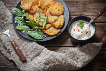 Potato Pancakes With Sour Cream On  Wooden Table