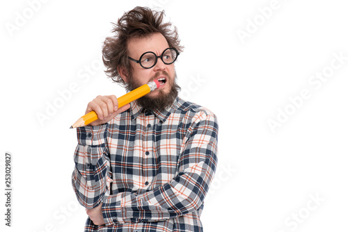 Fotomural  Crazy thoughtful bearded Man in plaid shirt with funny Haircut in eye Glasses holding Big Pencil - ponder and dreaming, isolated on white background