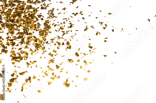 Fotografie, Obraz  Background with gold glitter, pieces of foil on white background for your design