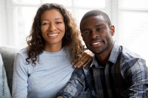 Fotografia  Portrait of happy mixed race couple posing for picture