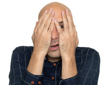 Afraid Man Covering His Face With Hands