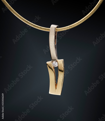 Golden necklace with gemstone isolated on black Fototapete