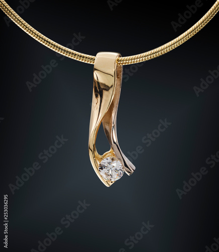 Leinwand Poster Golden necklace with gemstone isolated on black